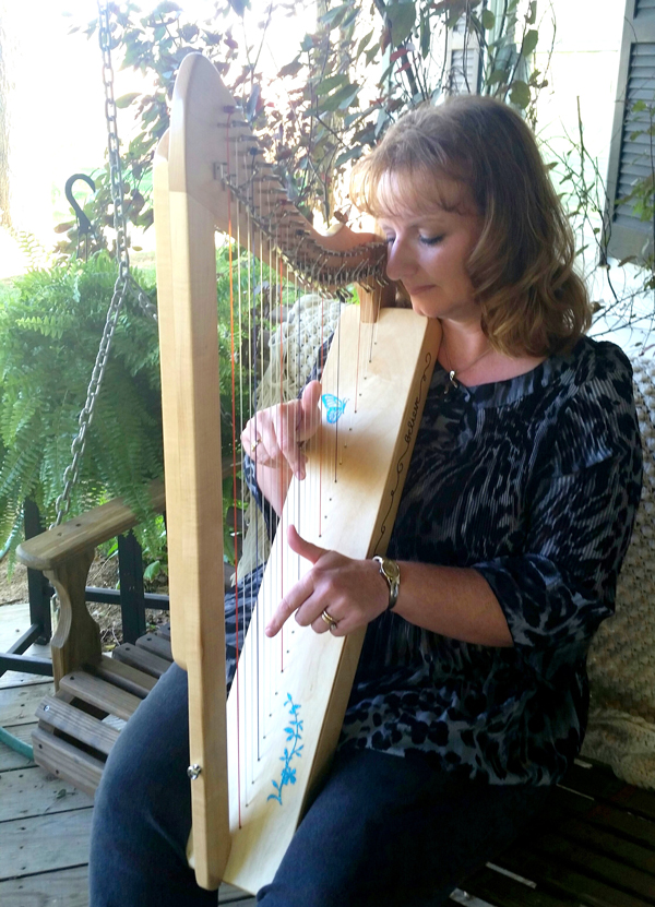 Robin playing the harp.